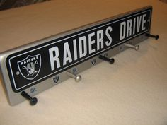 """Oakland Raiders coat rack """"hangup"""" silver (convo me for your favorite team) on Etsy, $36.00"""