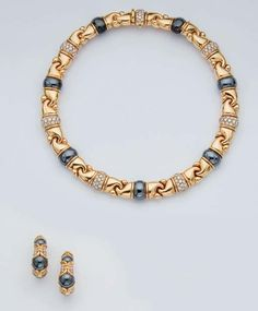 """A SUITE OF HEMATITE, DIAMOND AND GOLD """"GANCIO"""" JEWELLERY, BY BULGARI, earrings circa 1988 and necklace circa 1989"""