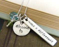 choose to make difference hand stamped necklace with green peridot and blue apatite beads ...pureroxinprint via Etsy.