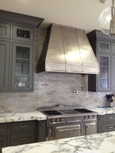Love the zinc hood, the Moroccan tiles and the gray cabinetry. Design: Kathleen DiPaolo