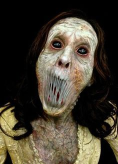 The creep factor is fantastic! She's hard too look at.... Halloween Makeup