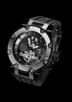 Predator Tourbillon. To highlight the unique refinement and simplicity of the tourbillon there is no dial. Hands of the hours and minutes are diamond-cut, hollowed, and then treated with high-visibility Super- LumiNova, ensuring excellent legibility and a brighter vision of time. For more information, please visit: http://www.rebellion-timepieces.com/uploads/downloads_documents/Predator%20Tourbillon%20English.pdf