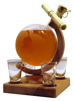 Globe and four glasses - a big world globe on a wooden stand with four shot glasses filled with 500ml of Highland Malt Whisky £59.84