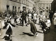 London in the at play. With no traffic in the street, except what looks like a cart parked in the distance, the children are able to form a circle and dance and play - some hopes today! Uk History, London History, British History, Family History, Victorian London, Vintage London, Old London, London Kids, Old Pictures