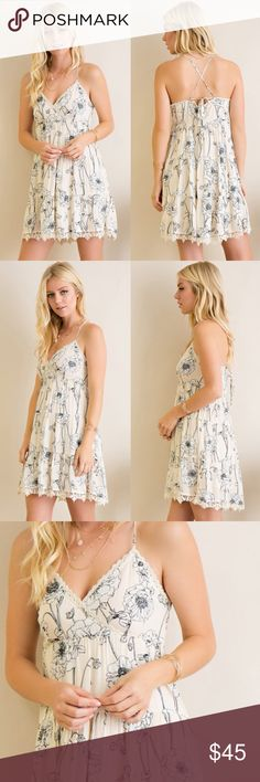 Floral Strappy Mini Dress Floral Strappy mini dress. Runs true to size. Brand new. NO TRADES DO NOT BOTHER ASKING. Bare Anthology Dresses Mini