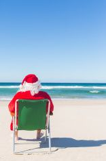 Santa Sitting on the Beach