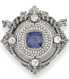 A belle époque colour change spinel and diamond brooch, circa 1900 The central cushion-shaped spinel within a finely pierced lozenge-shaped frame, millegrain-set throughout with single-cut diamonds and four larger old brilliant-cut stones, further decorated with similarly set foliate motifs at each lobe and a fluttering ribbon bow motif, diamonds approximately 5.00 carats total, French import marks, later brooch fitting, length 4.7cm., cased