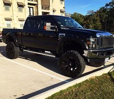 lifted black ford truck shiny black
