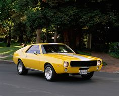 Yellow 1968 AMC AMX The AMX is a very good looking car.