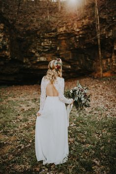 Long lace sleeves + cutout back = one of our favorite boho wedding dress designs | Image by The Marions