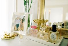 displaying perfume bottles is both functional and stylish because they are the prettiest decor pieces