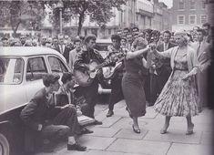 Teens dancing in the street (1950s)