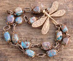 omg I love this bracelet...    Brass Dragonfly Bracelet by ByJenJenWithLove on Etsy, via Etsy.