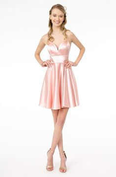 Dress to impress with this look by Elizabeth K GS2858. This satin cocktail dress features a plunging V-neckline with criss cross straps. It has a fitted bodice and a zipper closure. The skirt flourishes a mid-thigh, sassy, A-line silhouette. This Elizabeth K dress will make sure you turn heads all night long. Petite Dresses, Plus Size Dresses, Short Dresses, Pink Dresses, Sequin Dress, Lace Dress, Satin Cocktail Dress, Cocktail Dresses, Long Evening Gowns