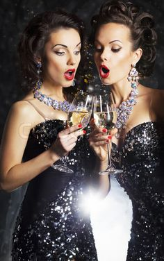 Image of 'Couple of cheerful women toasting at party with wineglasses celebrating'