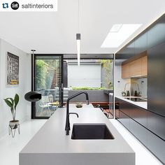 Modern industrial bliss with #Caesarstone Sleek Concrete. #Repost @saltinteriors. ・・・ Balmain kitchen complete! Featuring a combination of @caesarstoneau benchtops, timber accents and cabinetry in a sleek charcoal grey polyurethane. #saltinteriors #joinery #cabinetry #interiordesign #interior #architecture #design #style #kitchen #stone #industrial #concrete