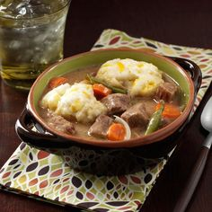 Beef Stew with Cheddar Dumplings Recipe -My family asks for this stew just about every week. But it's perfect for company, too—it's easy, and everyone comments on the cheese in the dumplings. —Jackie Riley, Garrettsville, Ohio