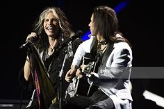 US singer-songwriter Steven Tyler (L) nd US singer Nuno Bettencourt perform on stage athe Nobel Peace Prize Concert at the Oslo spectrum on December 11, 2014. The 17-year-old Pakistani girls' education activist Malala Yousafzai known as Malala shares the 2014 peace prize with the Indian campaigner Kailash Satyarthi, 60, who has fought for 35 years to free thousands of children from virtual slave labour. AFP PHOTO / ODD ANDERSEN