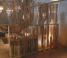 bamboo poles-room divider. Looks nice... think it would be even more beautiful shorter and painted white.