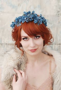 Blue flower crown contrasts gorgeously with red hair