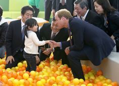 Prince William, Duke of Cambridge and Japanese Prime Minister Shinzo Abe play with children as they visit Smile Kid's Park on February 28, 2015 in Koriyama, Japan. The Duke of Cambridge is visiting Japan from February 26th to March 1st 2015.