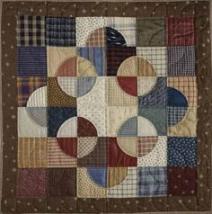 Nice setting of drunkard's path blocks from shirt quilt scraps (ignore link, which has nothing to do with this quilt pattern; it is an EPP how-to).
