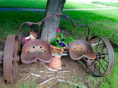 Vintage iron headboard, iron wagon wheels, and tractor seats repurposed to a garden bench. Horse shoes serve as drink holders. Backyard Seating, Garden Seating, Backyard Ideas, Outdoor Projects, Garden Projects, Outdoor Decor, Metal Projects, Welding Projects, Outdoor Ideas