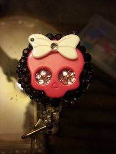 hot pink skull badge reel by CrochetingBella on Etsy, $5.00
