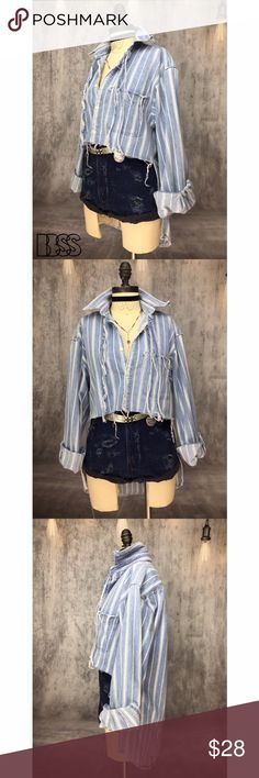 REWORKED VINTAGE GAP DENIM HIGH LOW BUTTON DOWN!! REWORKED VINTAGE GAP DENIM STRIPED HIGH LOW BUTTON DOWN!! Classic GAP DENIM 100% COTTON reworked vintage top! Distressing details all over with raw edges and fringes at neckline! PERFECT styling piece for SPRING/SUMMER! High low style is perfect for showing off your outfits and still covering up a little in the back! Your going to LIVE in this! MEASUREMENTS - BUST: 20.5' / LENGTH FRONT: 16.5' BACK: 31' Marked size SMALL fits like MEDIUM/LARGE…