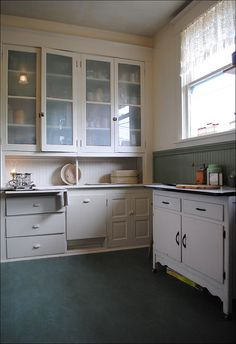1909 Faithful Kitchen Restoration by American Vintage Home, via Flickr. I like the glass fronted cabinets and the linoleum floor.