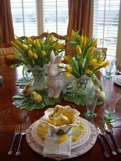 Spring Tablescape. I love the vases full of tulips flanking the bunny & chicks. This whole setting makes me smile.