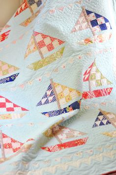 ... a styled shot of our SAIL AWAY pattern. Can't you just channel the beach when you look at those boats?