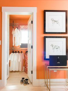 The guest bedroom's walk-in closet with a do-it-yourself organization system and window for natural light, features the same terra cotta wall color used for the rest of the bedroom.