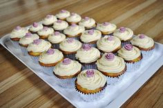 Vanilla purple rose cupcakes.