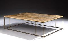 A Patinated Steel Coffee Table. Welded, patinated steel base. Timber top.