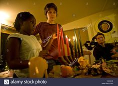 A 9 year old adopted girl lights Kwanza candles at her home in Stock Photo, Royalty Free Image: 24589415 - Alamy