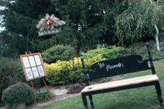 Daughters 1940's Vintage Style Wedding:Some of the items we made... Signature Bench repurposed from vintage double bed headboard...Window Program repurposed from a vintage window and Happily Ever After Sign from old Barn Wood
