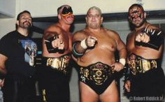 NWA World Six Man Tag Team Champions - Dusty Rhodes and The Road Warriors.