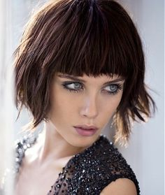 medium brown straight coloured messy iconic defined-fringe hairstyles for women, the rich chocolate shades massively compliment the blunt fringe and short bobbed hairstyle.