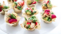 A quick and simple appetizer—sweet strawberries, cool and creamy avocado and savory chicken are tossed together in a citrus-honey-mustard vinaigrette. Perfect for parties, baby and bridal showers or any springtime entertaining!