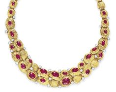 A RUBY, DIAMOND AND GOLD NECKLACE, BY VAN CLEEF & ARPELS   The front set with a graduated series of oval cabochon rubies, enhanced with circular-cut diamond detail, to the sculpted 18k gold link neckchain, mounted in 18k gold and platinum, 15 ins., with French assay marks and maker's mark  Signed Van Cleef & Arpels, no. 14687