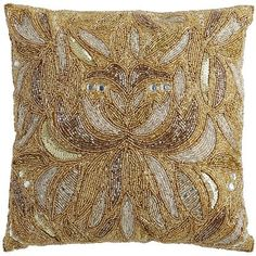 Ready to step up the glam? Our handcrafted, high-wattage pillow brings a Art Deco-inspired exuberance to any sofa or chair, with a symmetric array of metallic beads that resemble falling petals. Welcome to the luxe life.