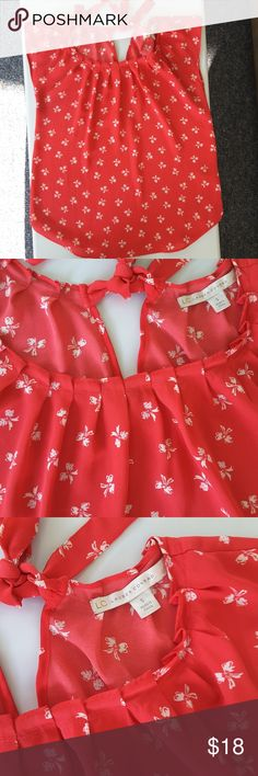 Small Lauren Conrad bow blouse Red/ coral color with white bows. Keyhole tie in back. Flowy. Excellent condition LC Lauren Conrad Tops Blouses