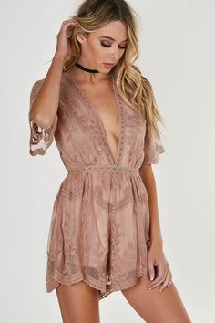 Delicate lace and crochet romper with short sleeves and plunging V-neckline. Hidden back zip closure with lining for coverage at bust and bottom.