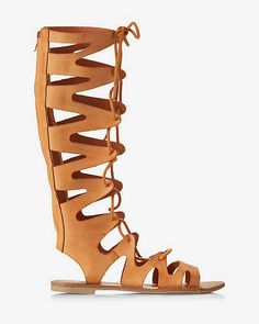 Get to stepping in a gladiator sandal that stands a little taller than the rest. The open strappy lace-up design gives it an architectural edge while a slim heel with an exposed zipper above offer easy access and comfortable wear.