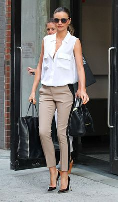 Black-panel khaki pants, white sleeveless button down (or button up, if you will), and pumps. Simple and classic.