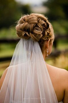 Wedding updo with veil underneath