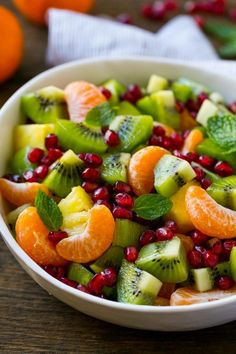 This winter fruit salad is made with oranges, kiwi, pineapple and pomegranates.
