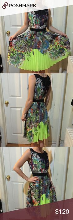 BCBGMaxAzria Sierra Neon Yellow Pleated Dress BCBGMaxAzria Dress in Sierra style with neon yellow accents and an abstract flower design all over! Pleated bottom- very elegant and unique. Size extra small! BCBGMaxAzria Dresses Midi