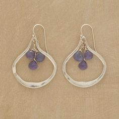 """Rivers of textured sterling silver engulf island chains of faceted tanzanite. Handcrafted in USA with French wires. 1-3/4""""L."""
